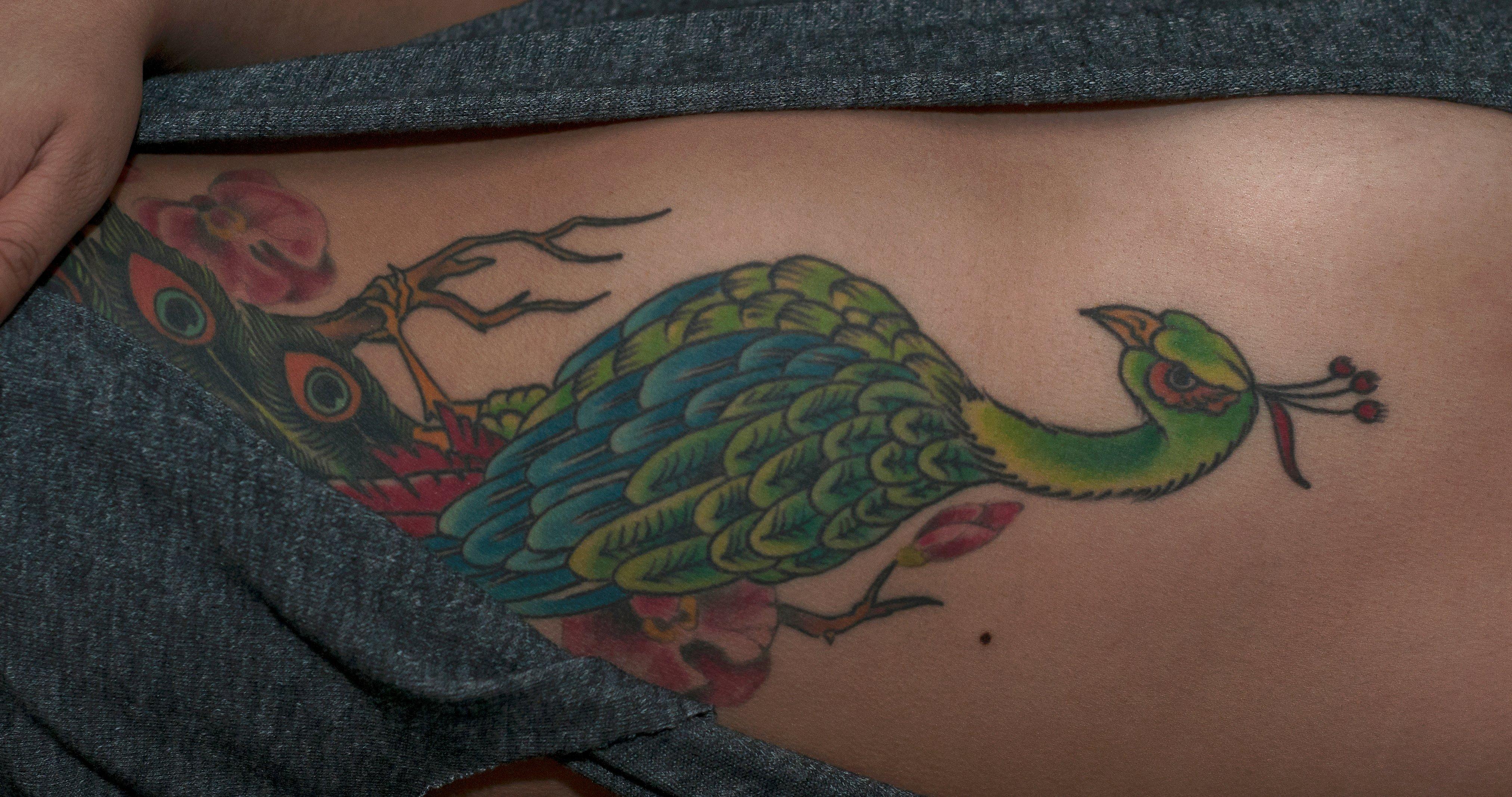 Pfau Tattoo Motive und Pfauenfeder Tattoo Bedeutung alletattoo.de 3
