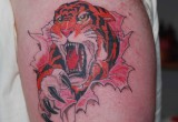 Tiger Tattoo am Oberarm